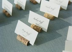 Cheap wedding idea: Cork Placeholders. Carefully cut in half, then slice slot for place card.
