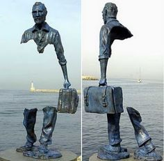 This is an example of positive/negative sculpture. This is because the man is missing the middle of his body. This negative space creates a shape out of the positive shape which is his legs, shoulders, face, and briefcase.