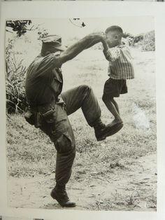 1996 U.S. soldier dances with a child in the Vietnam War. photo Donald Everett Dedera