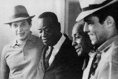 Pixinguinha com Tom Jobim, Chico Buarque e João da Baiana. Foto: Acervo Exposição Pixinguinha CCBB / Reprodução