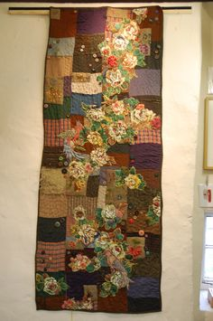 Gallery One - Mandy Pattullo applique needlepoint stitch onto salvaged stable boy quilt