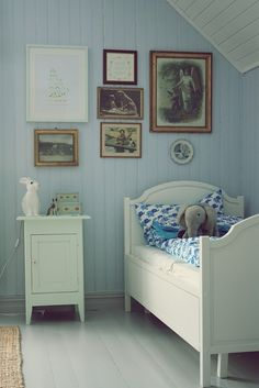 .I love the old fashioned pictures and the white stripped back look, very like our floors,