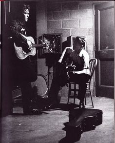 A great picture of Elvis Presley and Scotty Moore backstage in Dayton Ohio in 1956. This would have been Elvis's first solo tour. Moores guitar and Presleys movements were tied togeather on stage. Partners in crime so to speak. Something that Robert Plant and Jimmy Page would emulate years later.