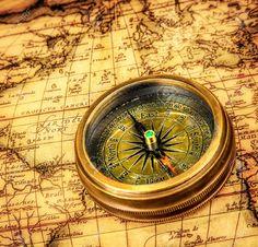 Vintage still life. Vintage compass lies on an ancient world..