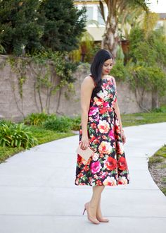 The perfect Spring rose printed midi dress from @chicwish paired with nude Christina Louboutin pumps and a structured clutch from @forever21. Click on the picture to go to the full outfit blog post!