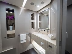 The plane is equipped with five bathrooms.