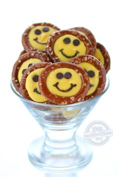 Make these smiley face pretzels using round pretzels, candy coating, mini chocolate chips and a food coloring marker.