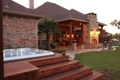 Cedar decking and steps surround this stand alone spa/hot tub making it not only more functional, but beautiful. By Outdoor Signature in Argyle, TX