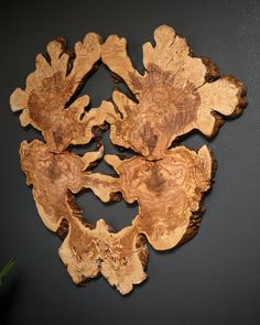 This 40 natural wall art piece was created from a bookmatch pair of Olive wood burl slabs joined together. Mounts to the wall using french cleat style bracket.