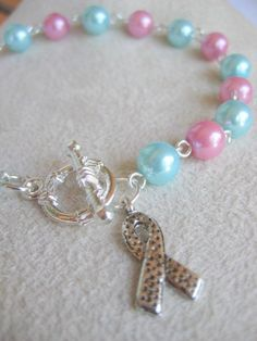 Infertility Infant Loss Pregnancy loss awareness bracelet with pink and blue glass pearls