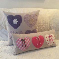 Hand-stitched hearts on pillows.