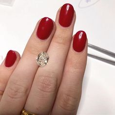 So pretty 😍 modified radiant cut diamond and classic red nails for the modern la