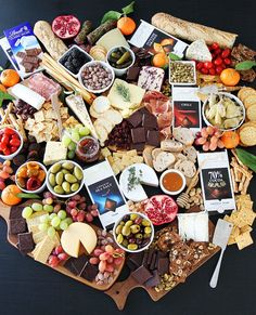 Cheese and Chocolate Board Recipe on twopeasandtheirpod.com This is the most amazing cheese board because it also has chocolate! It is the perfect appetizer for any party!