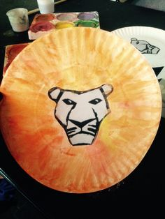 King Mufasa, Lion King Preschool Craft!  Took a paper plate (the kind you use for crafts) a print out of the lion from the lion king musical and water colour paint!  Glue the lion face in the middle and have them paint a lions mane around it in water colour paints! Looks really nice!  I even added golden glitter afterwards to the mane!  Fun and Easy for young kids!