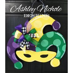 Mardi Gras Mask Door Hanger Mardi Gras Wreath ($50) ❤ liked on Polyvore featuring home, home decor, grey, home & living, home décor, wood home decor, grey home decor, mardi gras wreath, wooden door hangers and wood wreath