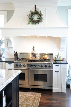 Love the wreath above the stove. danielle oakey interiors: home tour & merry christmas! Kitchen Hoods, New Kitchen, Kitchen Decor, Kitchen Cabinets, Kitchen Ideas, Kitchen Furniture, Upper Cabinets, Green Kitchen, Furniture Stores