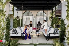 """Khloé's outdoor lounge area — pictured here — is representative of her romantic, Middle Eastern-inspired decor style. Of her and Kourtney's contrasting styles, Khloé said, """"Our tastes are very specific and completely different. When we go furniture shopping, I stand there tapping my foot while Kourtney shows me modern pieces. Then we head somewhere full of exotic, beautiful things and all she can say is, 'I like nothing here.'"""""""