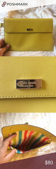 Kate Spade Wristlet Clutch Leather clutch, yellow-green color, rainbow lining, authentic kate spade, been used once so in pristine condition. no signs of wear and lining is completely clean. great for a night out or day to day activities! feel free to make a reasonable offer i'm open to negotiation! kate spade Bags Clutches & Wristlets