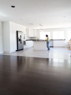 Garcia's Flooring - Orange, CA, United States. seamless transition from wood to tile in kitchen