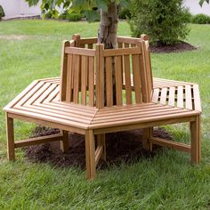 Turn your yard into a park-like atmosphere with this tree bench.     Joanne Teak Wood Tree Bench    http://www.signaturehardware.com/product16075#