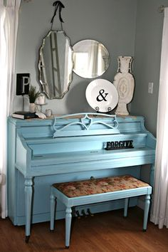 Out of the Attic: Painted Pianos. An old, unfixable piano would make an awesome entertainment center- neat way to hide ps3 and other boxes, cords, etc...