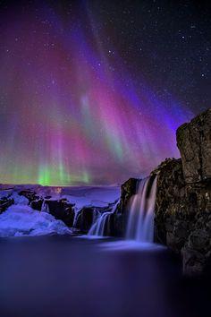 Kirkjufellsfoss Aurora - Kirkjufellsfoss waterfall under the Northern lights.  Photography Tours and Workshops in Iceland WEB Facebook