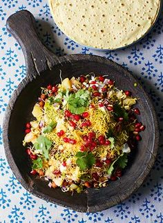 poppadom | date and tamarind chutney mint and yoghurt chutney 4 medium-sized new potatoes 1 x 400g tin of black chickpeas (kala chana), 1 red onion,  ½ teaspoon chilli powder a big bunch of fresh coriander  100g sprouted beans,  seeds of ½ a pomegranate ½ a lime