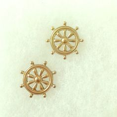 Summertime sailor studs A must have for boat rides, beach days, or just wishing you were out in the sun. These gold colored steering wheel earrings are a fun addition to any outfit. Jewelry
