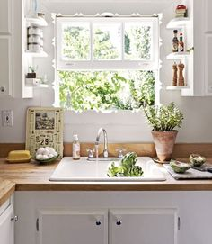 wood back splash, drop in sink. Love the little shelves along the window.