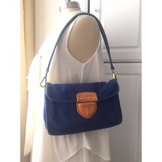 """Prada purse Authentic royal blue Prada clutch with orange accent. Perfect casual bag, can be worn with or without strap. Has side pockets on front and back, inside card holder pocket along with zipper pocket. Measurement 7"""" X 11 1/2"""" width 2 1/2"""" strap measures 25"""" Prada Bags Clutches & Wristlets"""