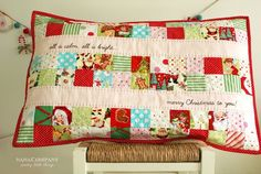 christmas fabric patchwork cushion with red binding and christmas quotes