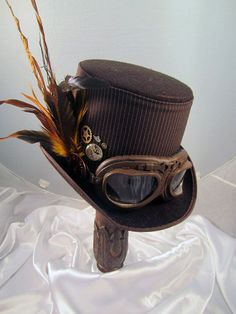 Steampunk Top Hat Mens Brown Top hat with peacock feather and Clock Parts. Description from pinterest.com. I searched for this on bing.com/images