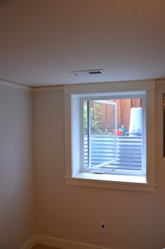 basement bedroom with casement egress window in a portland basement
