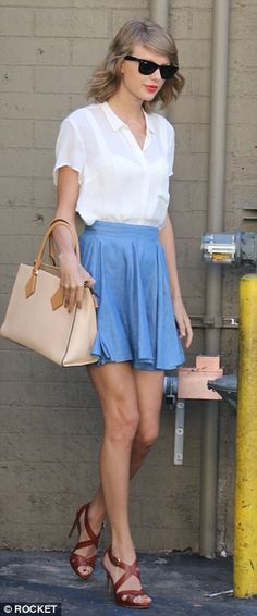 Keeping it simple: The 25-year-old star worked a flippy cornflower blue mini skirt, a sheer blouse and towering crossover-strap heels