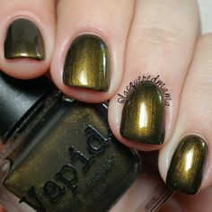 "Vapid Lacquer - Fall 2016 Collection ""Weaponized Guilt"" is a beautiful black base filled with deep gold shimmer that has a slight green tone to it!"