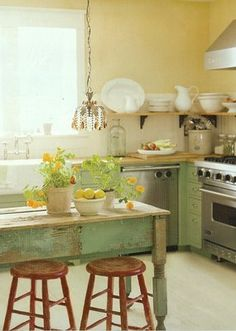 small kitchen remodel - farm sink, no upper cabinets, proper hood, good gas stove and nontraditional island....