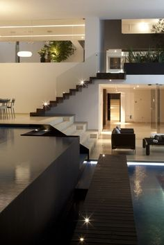 Modern interior design- open plan house with an indoor swimming pool.