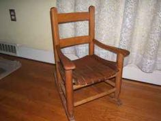 Vintage Children's slatted rocking chair.My husbands is sitting in our living room for the grandbabies, he's 60