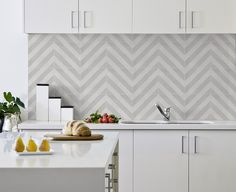 Milan ash kitchen splash back laid in a chevron pattern now available at Tiges's tiles
