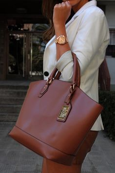 absolutely love this bag (and her cardigan) does anyone know where this is from?
