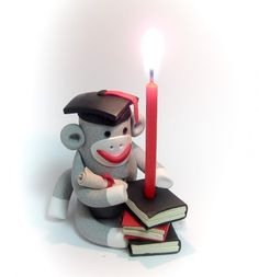 Graduation Sock Monkey Cake Topper doubles as a Candle Holder. Hand sculpted in Polymer Clay by MagicByLeah $70