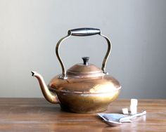 Vintage Copper Teapot Tea Kettle with Collapsible Handle. $32.00, via Etsy.