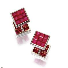 PAIR OF INVISIBLY-SET RUBY CUFFLINKS, ALETTO BROTHERS Each composed of two square links invisibly-set with square-cut rubies, connected by a two-part cylindrical post, mounted in platinum, signed Aletto Bros.