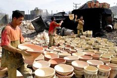 Pottery is a very ancient and traditional industry in Al khaleel, Falasteen. (They're *throwing* them!)