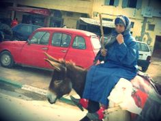 An old lady on the donkey in a small town outside Rabat