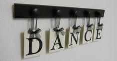 DANCE Art for Teenagers Room Sign - 5 Wood Knobs Painted Black Wall Letters DANCE. $25.00, via Etsy.