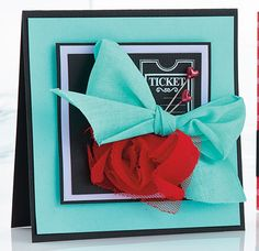Love the flower and ribbon fluff on this card, not to mention the stunning color combination
