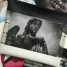 Just an example of what you can do with the ICON Maxi Photo Clutch Bag! You can change the photo anytime you want to suit your mood using the PVC pocket within the bag. #bag #clutchbag #clutch #handbag #photo #custom #personalise #personalize #fashion #unique #PVC #black #white #clear #fun #style #angel #neon #lips #horror #sky #etsy