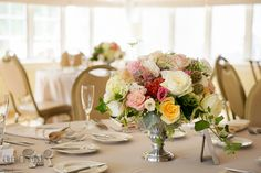 Table setting and pastel roses flower centerpiece by Mobtwon Florals. Aspen Wye River Conference Centers wedding at Queenstown Maryland, by wedding photographers of Leo Dj Photography. http://leodjphoto.com