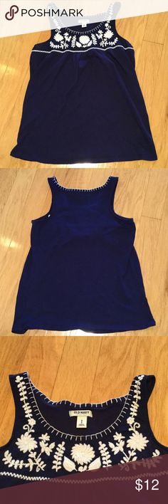 Old Navy Embroidered Tank Beautiful navy blue cotton tank from Old Navy.  White embroidery accent the neckline in great contrast with the navy blue color.  Length to the hips. Old Navy Tops